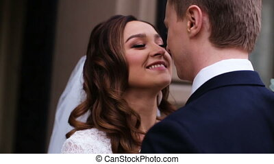Beautiful young couple just entered from the church where...