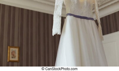 Elegant wedding dress on a hanger specially made for a...