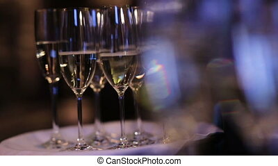 A row of glasses with champagne inside ready to be served...