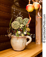 Interior of hunting lodge - Bouquet of wild flowers in a...