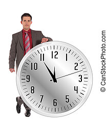 time limit - A handsome businessman standing next to a huge...