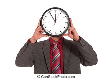 Eleventh hour - A businessman holding a clock that shows the...