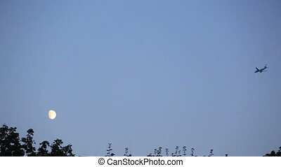 Plane flying over the countrside. evening