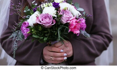 Colorful Wedding Bouquet At Bride's Hands