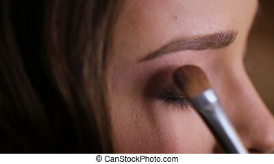 Close up of proffesional make up artist doing make up for a...