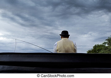 Coachman in a carriage, cloudy sky on background