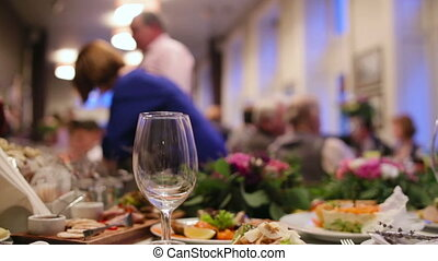 Close up of food and empty glasses on a wedding ceremony.