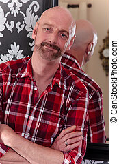 Bald middle aged man home