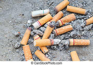 Cigarette burning in ashtray - Cigarette burning in outdoors...