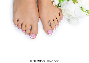 Woman feet with french pedicure