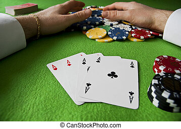 winning with poker of aces - winning many chips with poker...