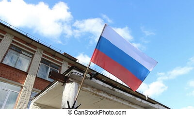 russian flag on school on blue sky background