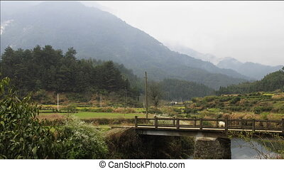 wuyuan2.mov - time lapse of clouds passing by mountain,a...
