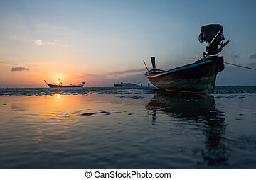 Longtail boat snset - Traditional thai boats at sunset...