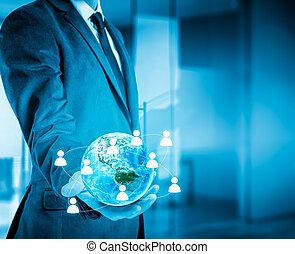Businessman holding globe in his hands. The concept of...