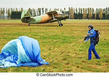 girl, parachute and aircraft - The girl in dark blue...