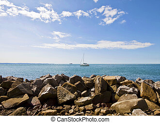 Trieste, Italy - view of rocky strand of S Croce, naturistic...