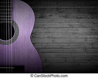 Part of a pink acoustic guitar on a gray wooden background....