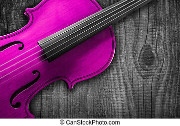 Pink Violin on grey wooden background. With space for text...