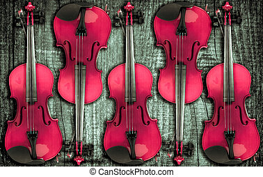 Violin on grey wooden background. With space for text...