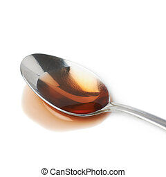 Steel spoon in a puddle of wine vinegar isolated over the...