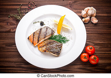 Grilled mackerel fish with vegetables and seasoning