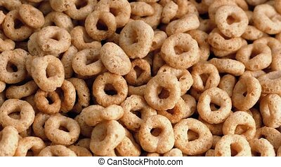 Honey Flavored Cereal Loops Rotate - Golden cereal hoops...