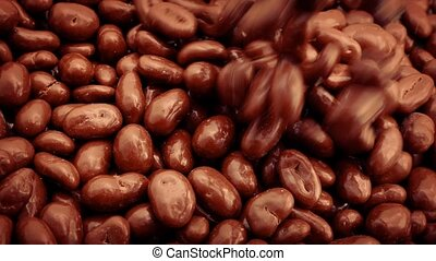Pouring Chocolate Coated Peanuts - Chocolate covered peanuts...