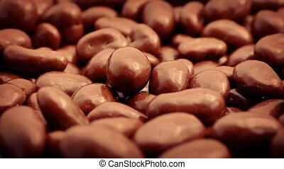 Chocolate Covered Peanuts Rotating - Chocolate coated...