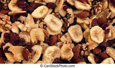 Fruit And Nut Mix Rotating Closeup - Mixture of dried...