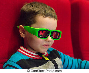 Little boy watching movie in 3d glasses