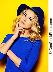 curly blonde hair - Bright fashion concept. Beautiful girl...