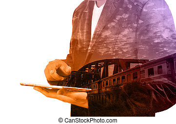 Double Exposure of Business Man use Tablet and Train over...