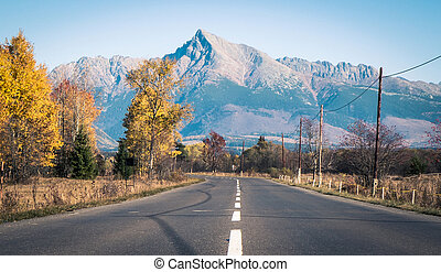 Empty road and hill Krivan - Empty road and High Tatras...