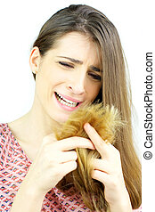 Beautiful woman crying looking split ends hair isolated