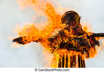 Burning down effigy of Shrovetide during Shrovetide...
