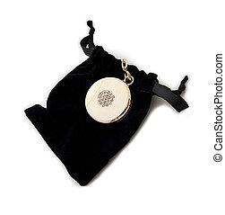 Elegant gold charm and black velvet bag