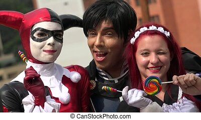 Happy Cosplay Friends With Lollipops