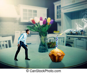 Man blowing out a candle - Businessman blowing out a big...