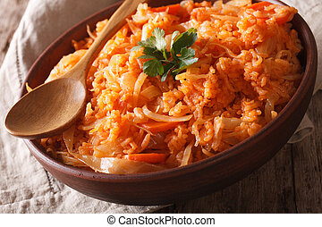 Mediterranean cuisine: rice with cabbage close up in a bowl. horizontal