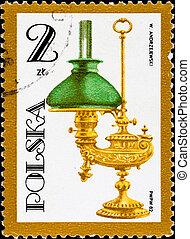 postage stamp shows vintage kerosene lamp - POLAND - CIRCA...