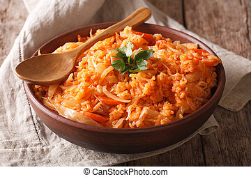 Greek lahanorizo rice with cabbage close up in a bowl. horizontal