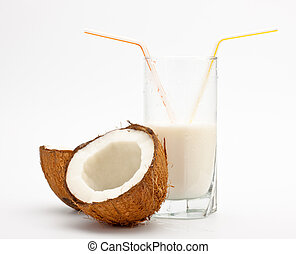 coconut and glass with coco milk, grey background