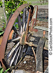 Old rusty wagon wheel on farm