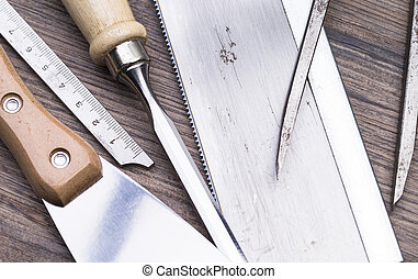 Tools on table - Image shows a set of tools on wooden table...