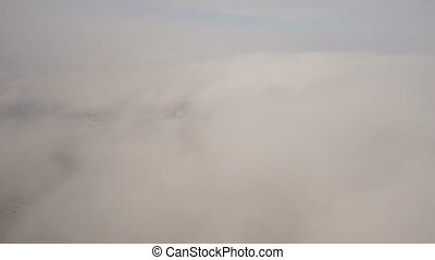 View from the descending aircraft on clouds - Aerial view...