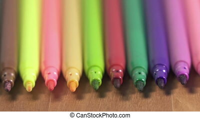 felt-tip pens of various color lie in a row