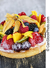 Mixed tropical fruit tart - Fresh dessert fruit tart covered...