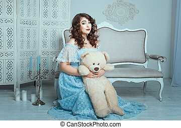 Plump woman with a toy bear - Plump woman with a toy bear...