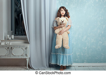 Plump woman with a bear in hands - Plump woman hugging toy...